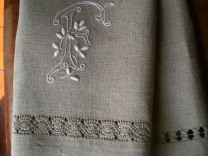linen towel embroidered with monogram and drawn threads